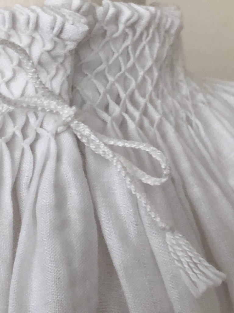 Close up of smocking on neck