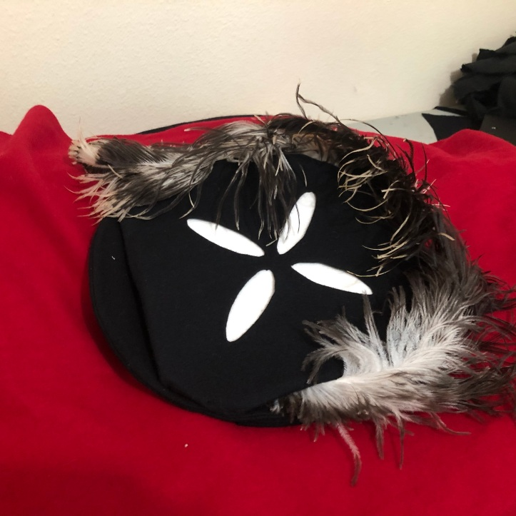 Top view of child's German trossfrau hat with reworked feathers.