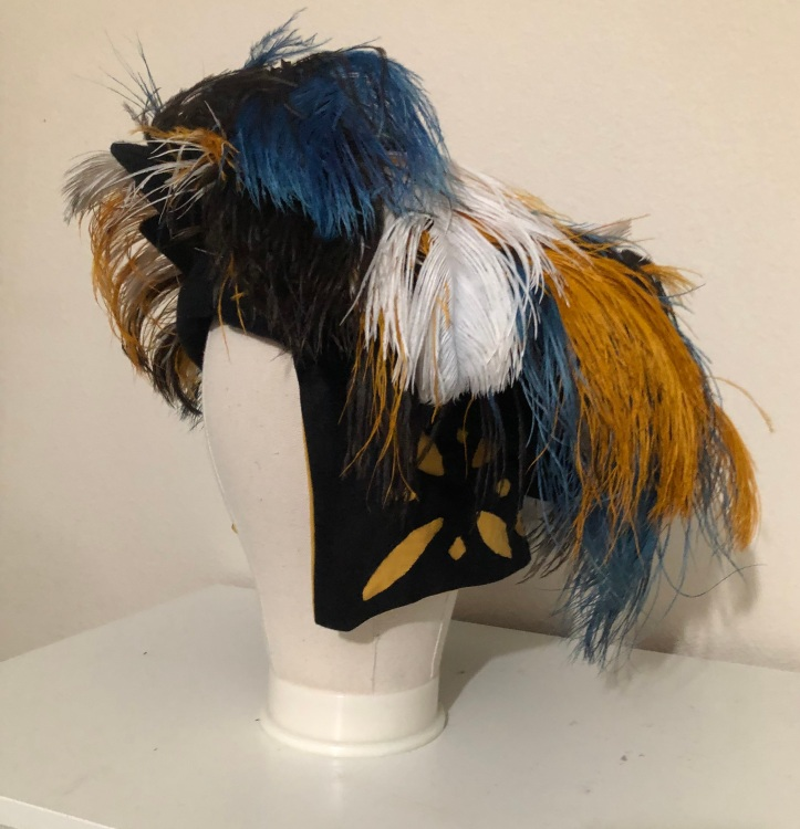 Landsknecht style dockenbaret with ostrich feathers.