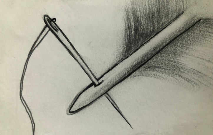 Piercing the quill with the needle.